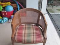 I have a round plaid bucket shaped chair available for