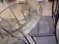 I have a round table for sale with 4 chairs it's in