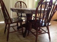 Dinning table with 4 chairs. Solid, brown perhaps