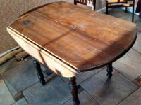 I'm selling a nice, solid round wooden table. It's
