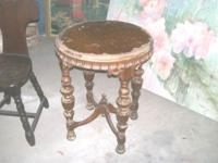 "Vintage wood round table. 21"" in diameter, 27"" tall."