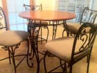 Good condition round table and 4 upright chairs