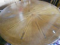 nice round table with 5 chairs  $150  has a few spots