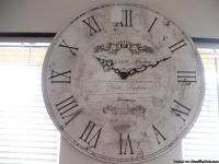 Very pretty large, white wall clock.  Has shades