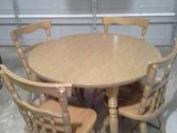 Selling this round consuming table with 4 chairs. It's