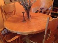 Wooden country style table that has extra leaf to make