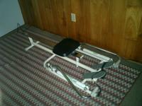TUNTURI rowing machine with piston driven hydraulic