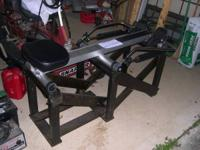 Rowing machine mounted on stand.  Adjustable resistance