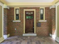 This grand 1923 Colonial brick home exemplifies the