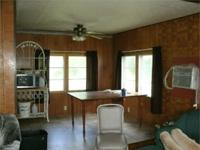 This double-wide manufactured house on 2 acres m/l