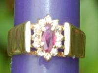 Pre owned ruby and diamond ring size 5 1/2. $350.00