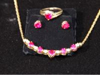 Pre owned ruby and diamond necklace, earrings, & ring