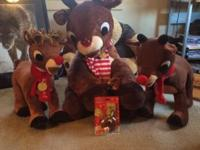 One huge Rudolph stuffed animal, two medium size one