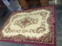 8' X 10' Burgundy rug out of a bank. Good condition. No