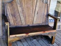 This barn wood bench is done in a rustic style and it
