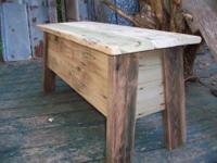 This barn wood bench chest is located at Rustic Trails