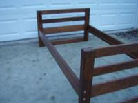 This is a nice sturdy set. Comes with headboard