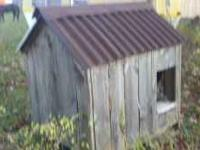 "This hand made dog house is built with 1"" lumber and"
