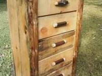 Rustic rough sawed log dresser built in the