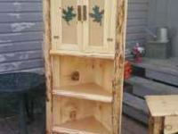 this is a rustic log corner cabinet ...space saver for