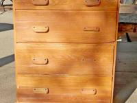 This is a rustic oak high boy dresser, made of solid