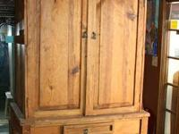 I am selling this nice looking rustic pine cabinet that