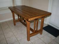 This is a handmade rustic farm table is made from air