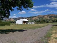 Nice MH & attached carport. Property includes an