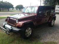 Come see this 2010 Jeep Sahara with tow bar and tow