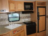 Immaculate non-smoking trailer has spacious living area