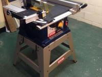 RYOBI BTS15 10 in. table saw, with stand and manual.