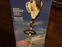 NIB two cycle engine curved shaft trimmer. The Ryobi 17