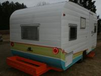 We hand painted camper with bright vintage colors and a