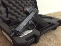 9mm Pistol -Red Dot included -Case and grips included