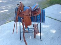 Western saddle only used once. The saddle seat is 14
