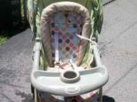 Safety First Stroller, green color with polka dots and