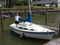 1982 Starwind 22 foot Sailboat.   Parked in yacht club