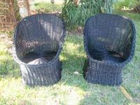 Set of 2 fabulous black wicker chairs. Not sure of the
