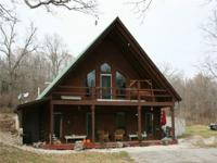 3724 LOG HOME ON 18+ ACRES. Private setting with the