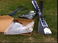 Skis and boots, women's size 8. Hardly used. Package
