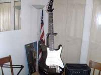 Black Samick electric guitar (strat style), plays
