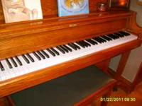 Samick upright piano, includes the bench. It is made of