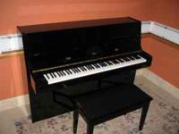 This is a modern style Samick piano. The piano is in