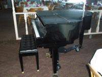 This is a beautiful Samick Baby Grand Piano for sale.