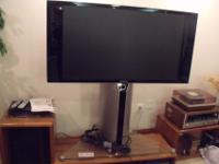 This large TV w stand  Integrated Pedestal w base  Can