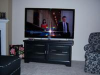 55 INCH SAMSUNG TV AND BLACK WOOD WITH GLASS STAND TV