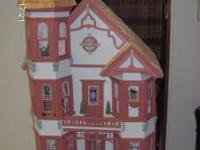 This dollhouse is completely furnished and has