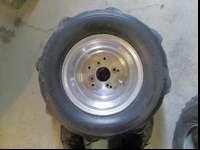 selling 2 rear 8 paddle tires with rims 20x10-10, they