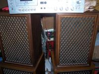 This is a pair of Sansui SP-50 two way speakers. Walnut