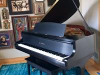 Kawai baby grand piano in satin black with original
